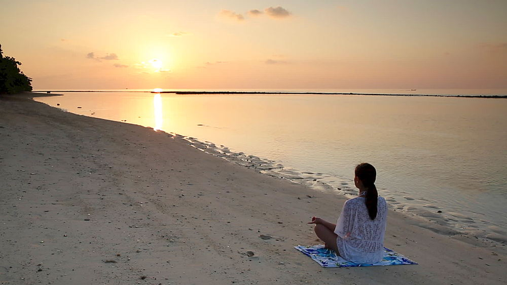 Woman practicing yoga on beach at dawn, Rasdhoo Island, Northern Ari Atoll, Maldives - 800-2941