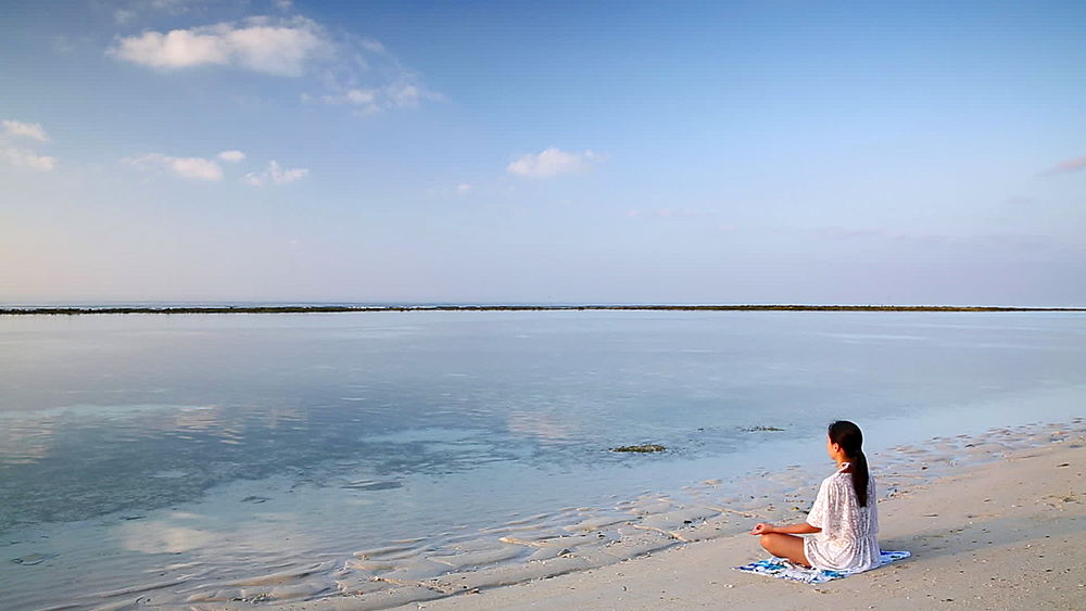 Woman practicing yoga on beach at dawn, Rasdhoo Island, Northern Ari Atoll, Maldives - 800-2942