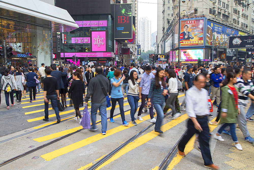 Pedestrians crossing street, Causeway Bay, Hong Kong Island, Hong Kong, China, Asia