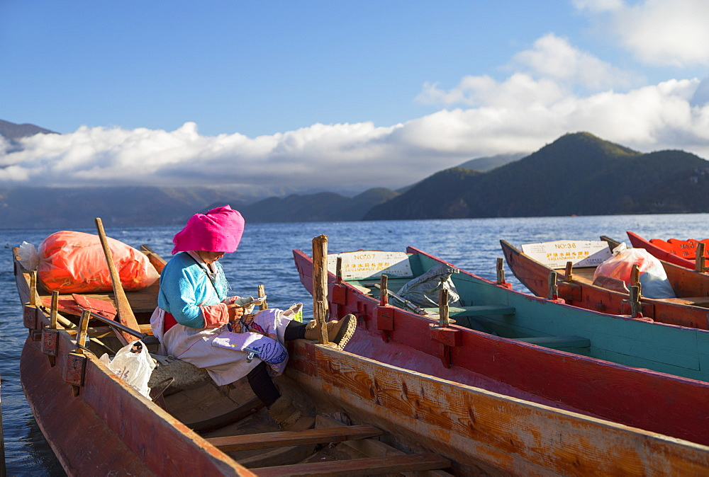 Mosu woman on boat, Luoshui, Lugu Lake, Yunnan, China, Asia - 800-3021