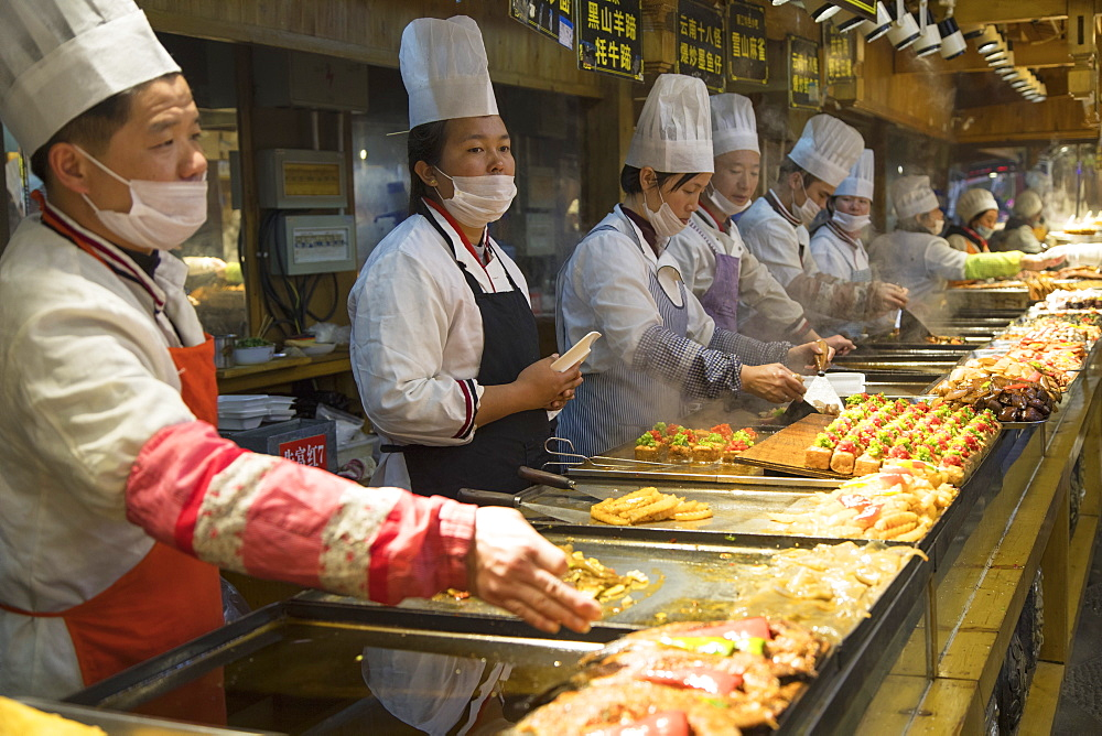 Chefs in food centre, Lijiang, UNESCO World Heritage Site, Yunnan, China, Asia - 800-3026