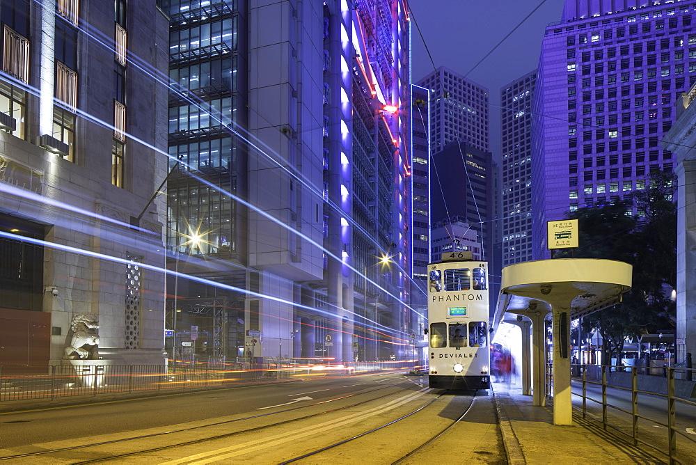 Trams passing Bank of China Building and HSBC Building, Central, Hong Kong, China, Asia - 800-3042