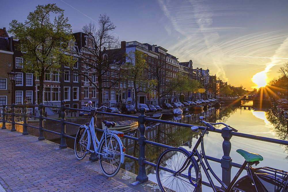 Bicycles on Keizersgracht canal at dawn, Amsterdam, Netherlands, Europe