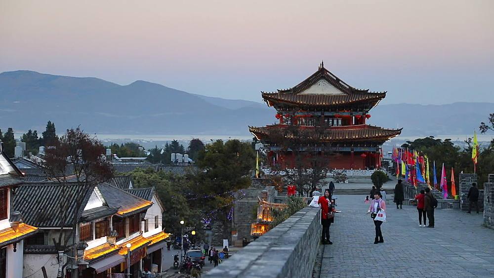 People on city walls, Dali, Yunnan, China, Asia