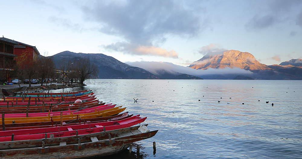 Boats on Lugu Lake at dawn, Yunnan, China, Asia