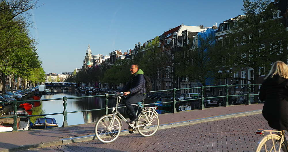 Cyclists crossing Keizersgracht canal, Amsterdam, Netherlands - 800-3168