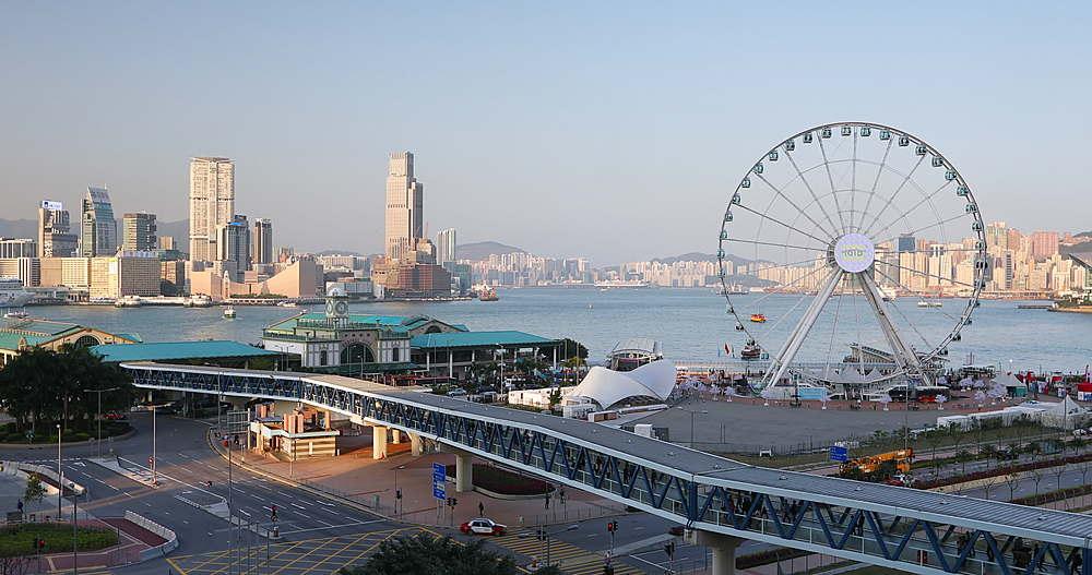 View of Ferris wheel and Tsim Sha Tsui skyline from International Finance Centre (IFC), Hong Kong, China, Asia