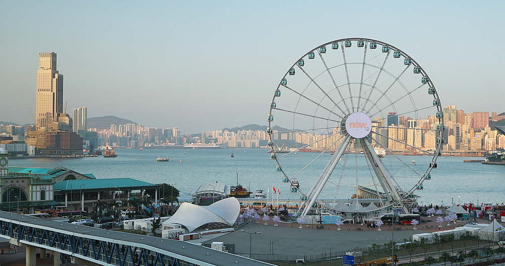 View of Star Ferry pier and Ferris wheel, Hong Kong, China, Asia