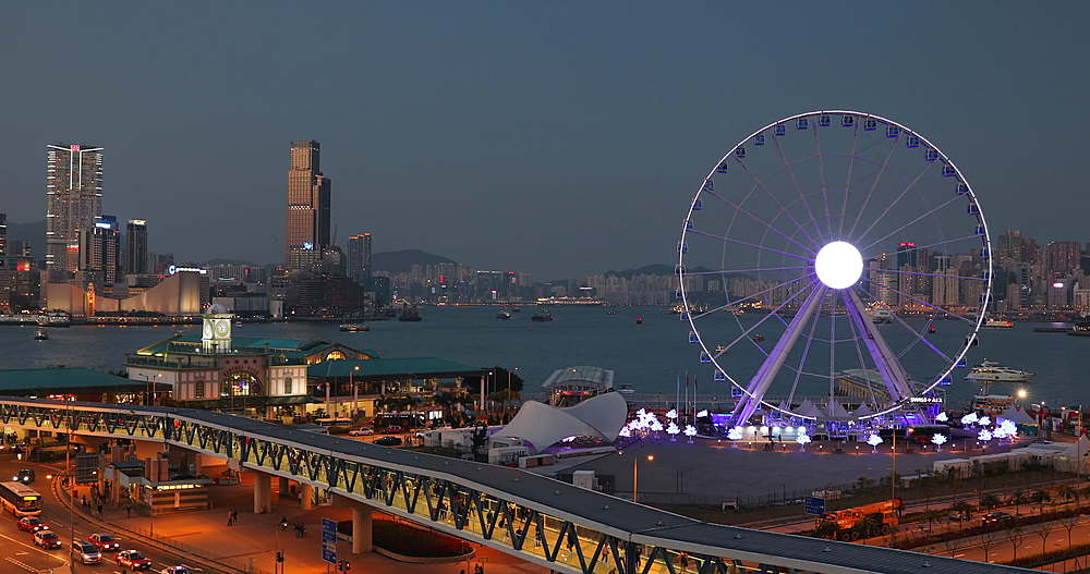 View of Star Ferry pier and Ferris wheel at dusk, Hong Kong, China, Asia - 800-3178
