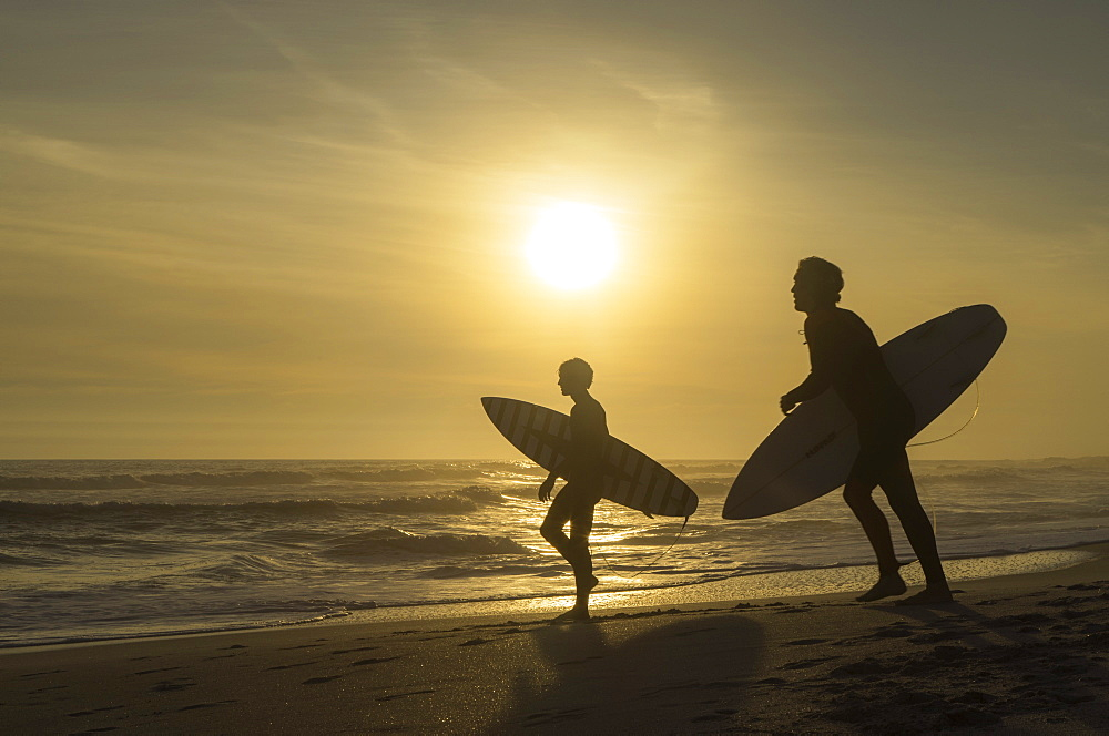 Surfers on Bloubergstrand at sunset, Cape Town, Western Cape, South Africa - 800-3190