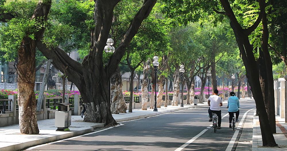 People cycling along road in Dongshan area, Guangzhou, Guangdong, China - 800-3243