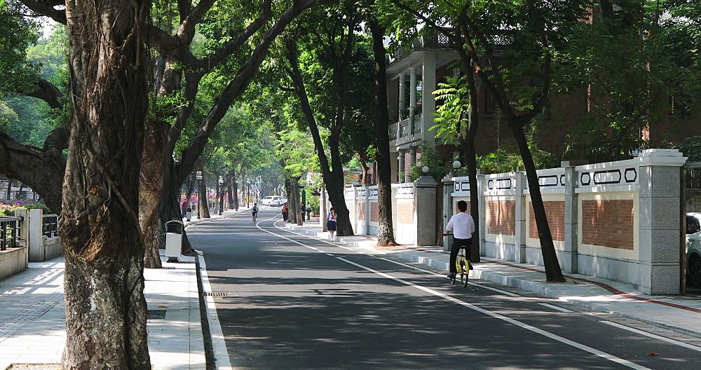 People cycling along road in Dongshan area, Guangzhou, Guangdong, China - 800-3244