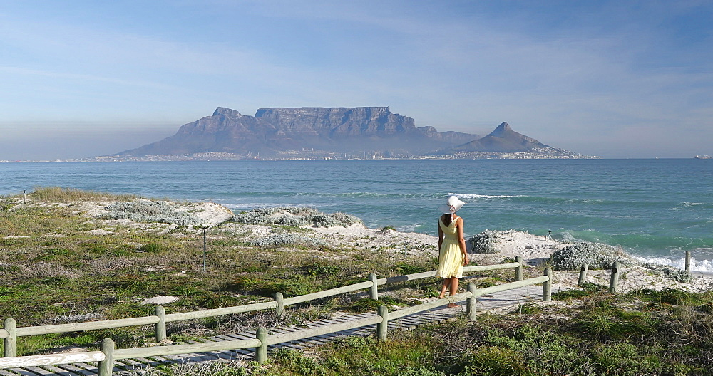 Woman walking on Bloubergstrand, Cape Town, Western Cape, South Africa, Africa - 800-3287