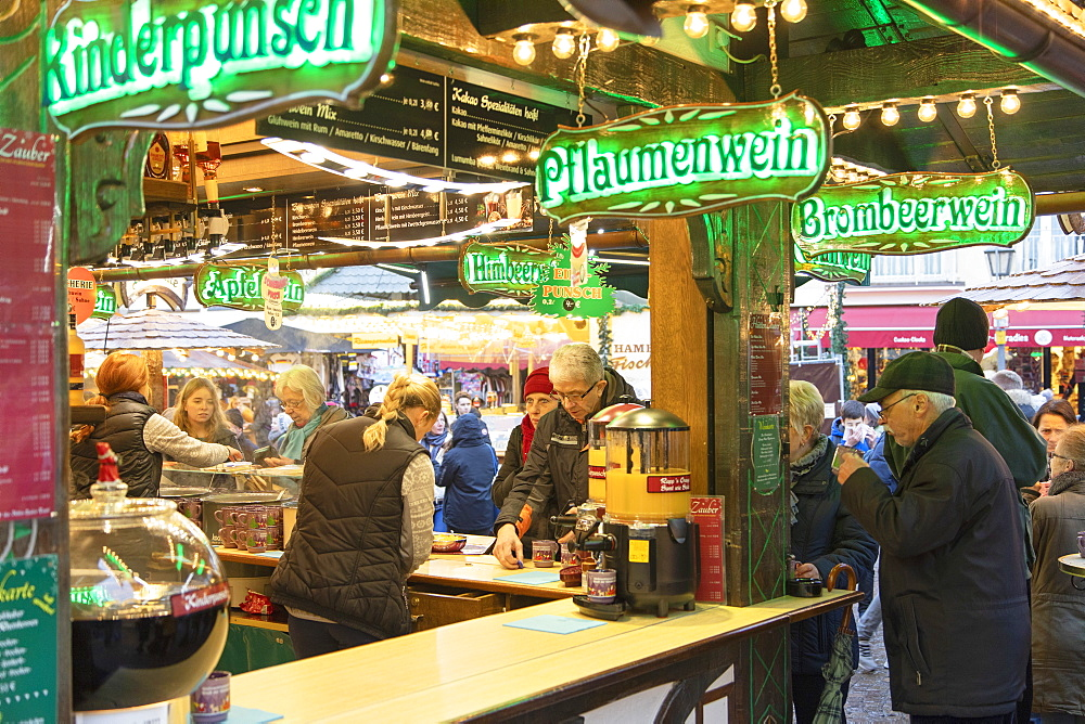 People at German mulled wine stall at Frankfurt Christmas Market, Frankfurt am Main, Hesse, Germany