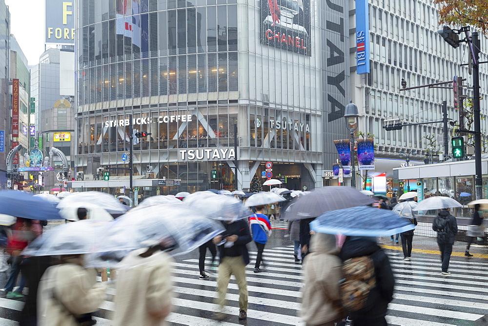 People walking across Shibuya Crossing, Shibuya, Tokyo, Japan