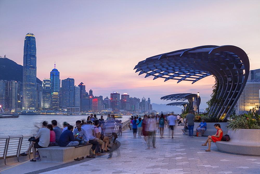 Skyline of Hong Kong Island and Tsim Sha Tsui promenade at sunset, Hong Kong, China, Asia