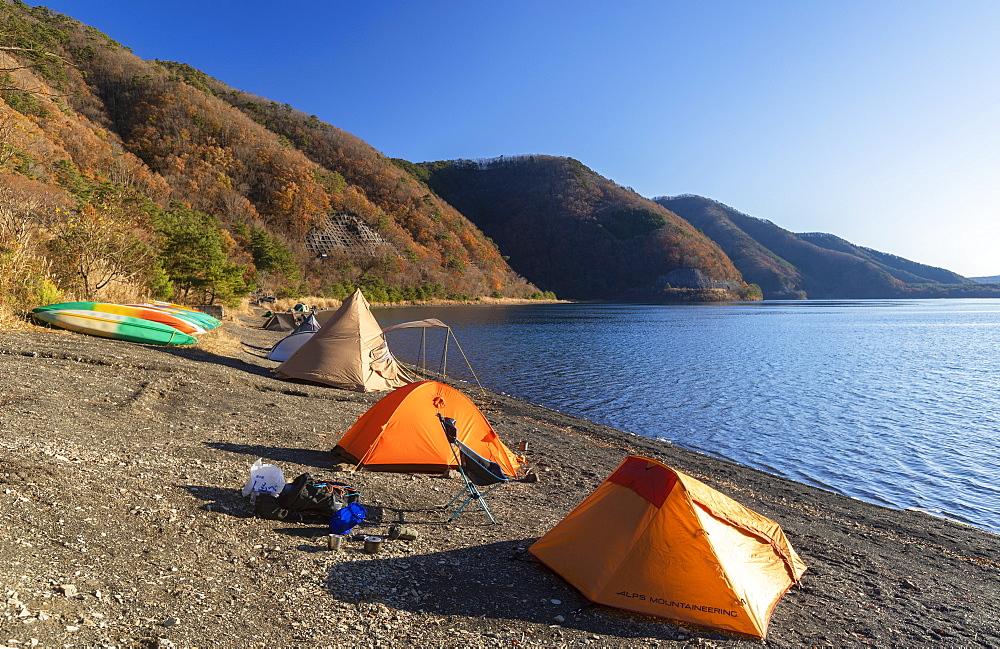 People camping next to Lake Motosu, Yamanashi Prefecture, Honshu, Japan, Asia