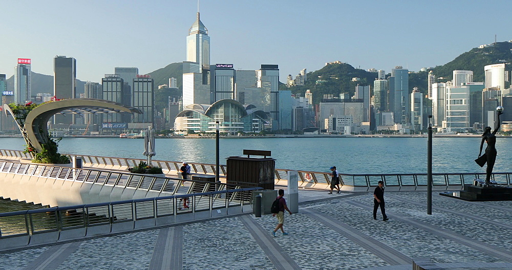 People walking along Tsim Sha Tsui promenade, Hong Kong, China, Asia