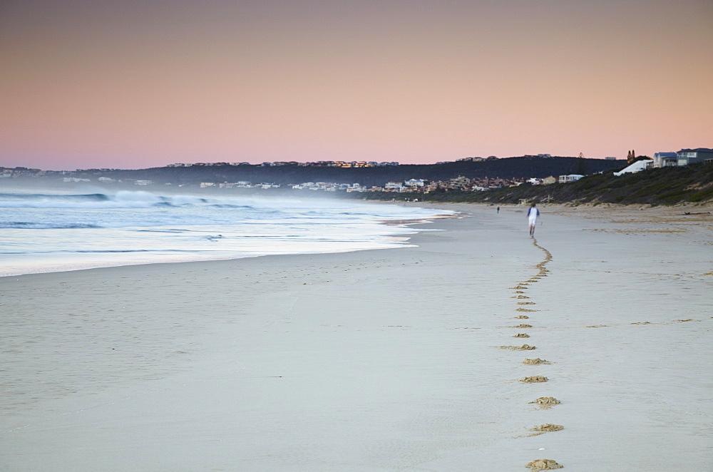 Man jogging on beach at dawn, Plettenberg Bay, Western Cape, South Africa, Africa - 800-448
