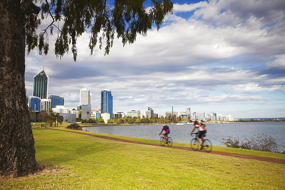 People cycling alongside Swan River, Perth, Western Australia, Australia, Pacific