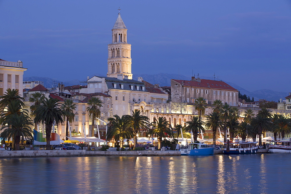 The Riva in the foreground and Cathedral of St. Dominus Tower in background at sunset, Split Harbor, Split, Dalmatia, Croatia, Europe