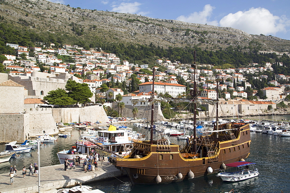 Old Harbor with vintage looking tourist boat, Dubrovnik, Croatia, Europe