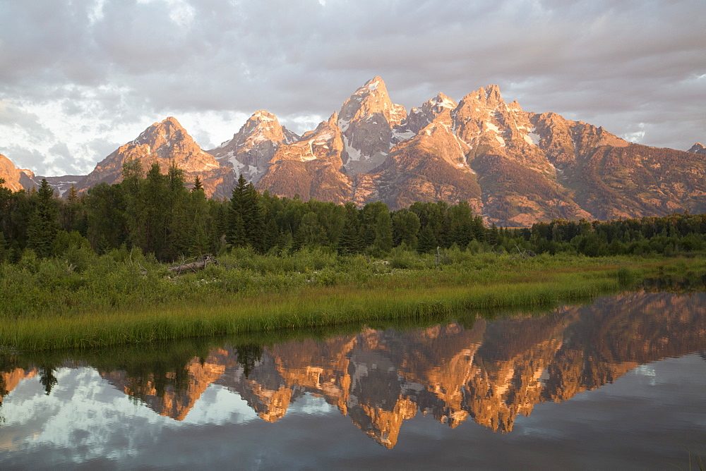 Water reflections of the Teton Range, taken from the end of Schwabacker Road, Grand Teton National Park, Wyoming, United States of America, North America