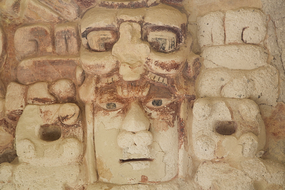 Stone mask of Mayan Sun God Kinichna, taken through protective glass, Becan, Mayan Ruins, Campeche, Mexico, North America