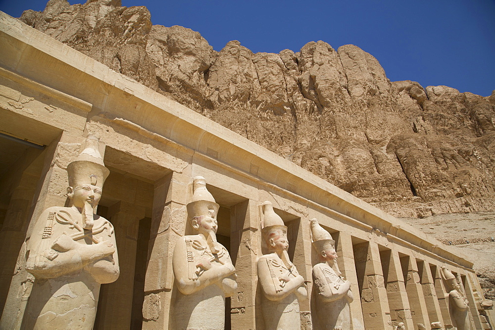 Statues of Osiris, Deir-el-Bahri (Hatshepsut's Temple), West Bank, Thebes, UNESCO World Heritage Site, Egypt, North Africa, Africa