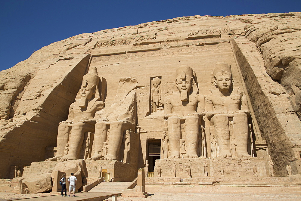 Tourists enjoying the site, Colossi of Ramses II, Sun Temple, Abu Simbel, UNESCO World Heritage Site, Egypt, North Africa, Africa - 801-1656