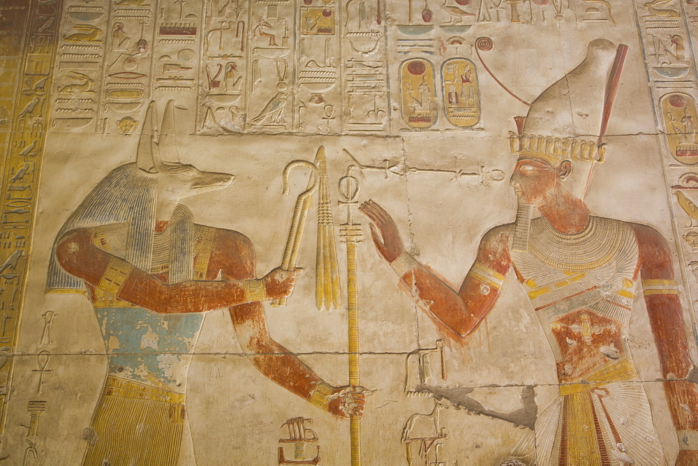 Bas-relief of the God Anubis on left and Ramses II on right, Temple of Seti I, Abydos, Egypt, North Africa, Africa