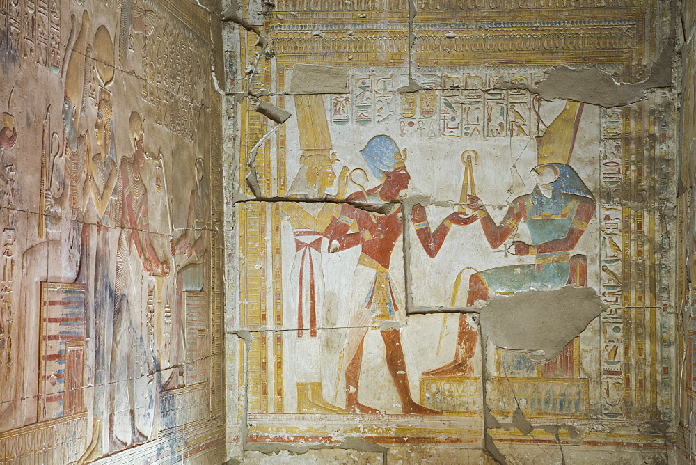 Bas relief of Pharaoh Seti I making an offering to the seated God Horus on right, Temple of Seti I, Abydos, Egypt, North Africa, Africa