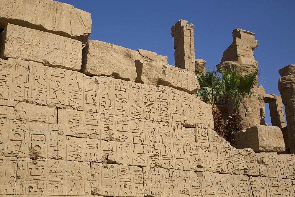 Hierogylphics on wall opposite Cachette Court, Karnak Temple, Luxor, Thebes, UNESCO World Heritage Site, Egypt, North Africa, Africa
