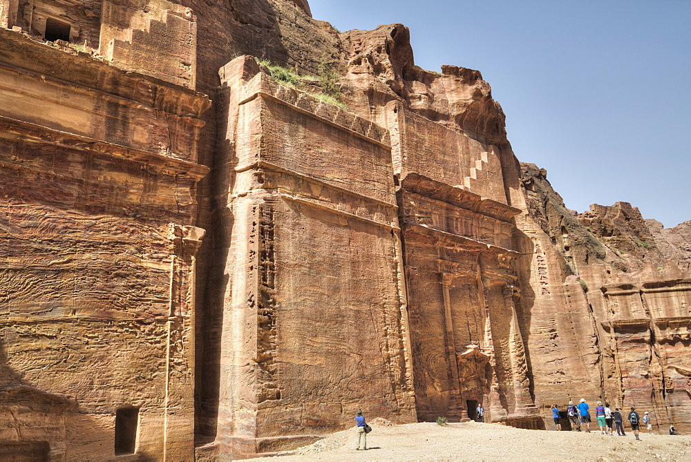 Tourists in front of Facade, The Street of Facades, Petra, UNESCO World Heritage Site, Jordan, Middle East