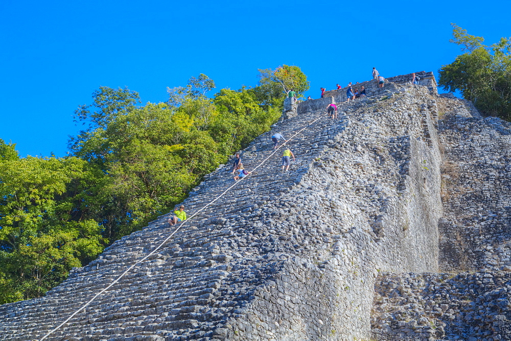 Tourists climbing the temple, Nohoch Mul Temple, Coba, Quintana Roo, Mexico, North America