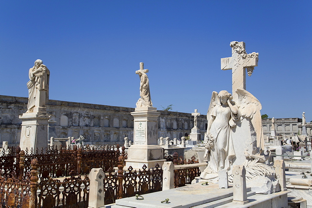 Statue of Archangel in foreground, La Reina Cemetery, Cienfuegos City, UNESCO World Heritage Site, Cienfuegos, Cuba, West Indies, Central America