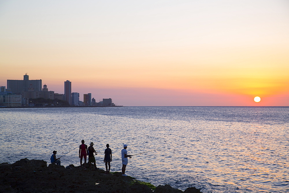 Locals fishing from the Malecon in the evening, Centro Habana, Havana, Cuba, West Indies, Central America