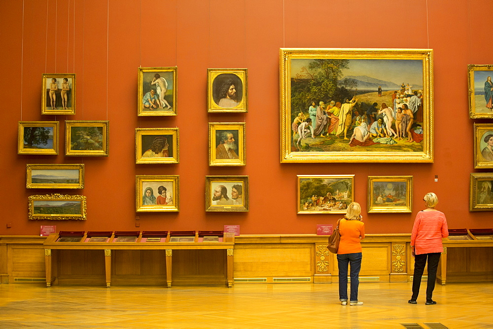 Tourist viewing 19th century Russian paintings, Russian Museum, UNESCO World Heritage Site, St. Petersburg, Russia, Europe
