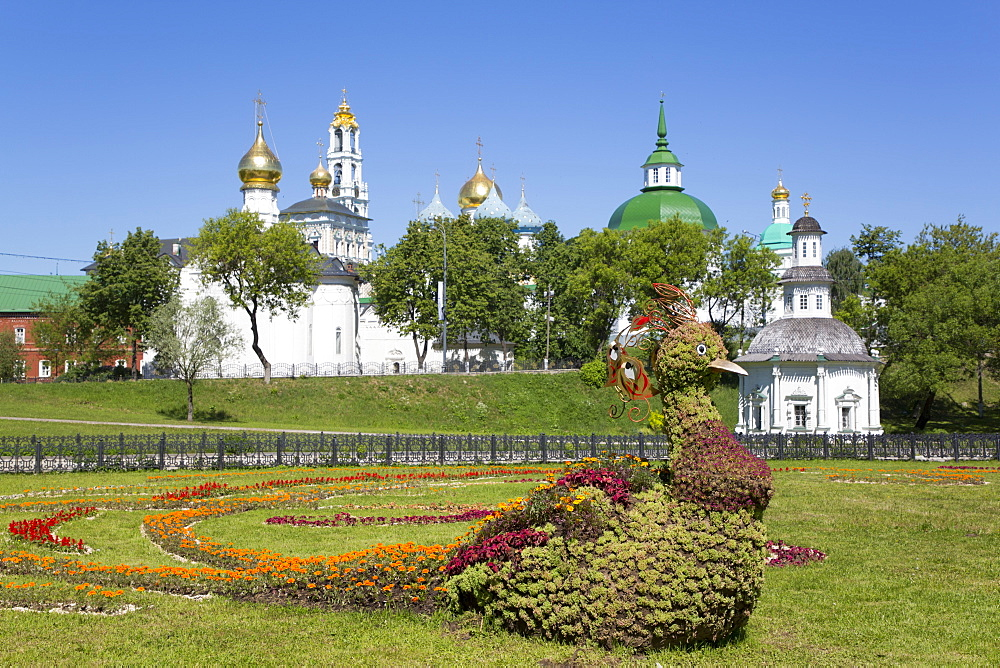 Bird made of flowers in foreground, The Holy Trinity Saint Sergius Lavra, UNESCO World Heritage Site, Sergiev Posad, Russia, Europe