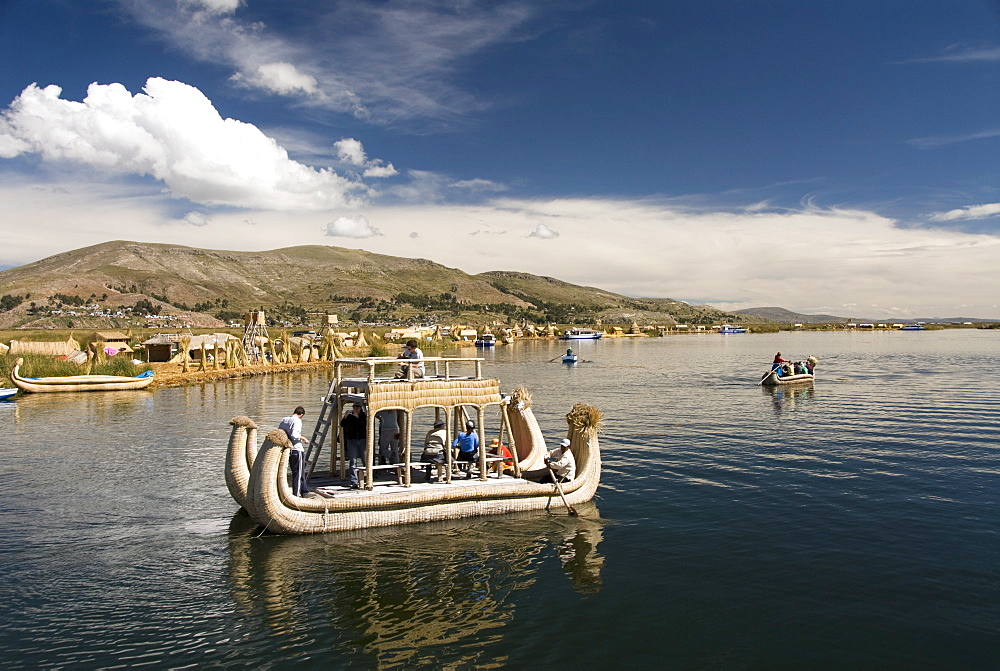 Tourists on reed boat and the floating islands of the Uros people, Lake Titicaca, Peru, South America