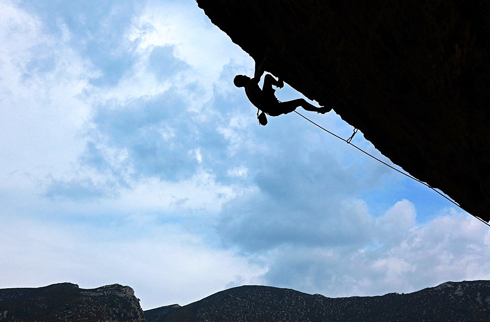 A climber tackles a severely overhanging route in the caves of the Mascun Gorge, Sierra de Guara mountains, Aragon, Spain