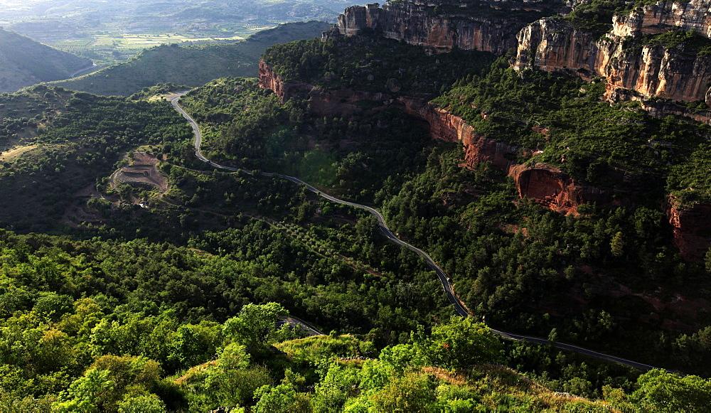 View across the limestone ravine beaneath the medieval village of Siurana, near Reus and Barcelona, Catalonia, Spain, Europe