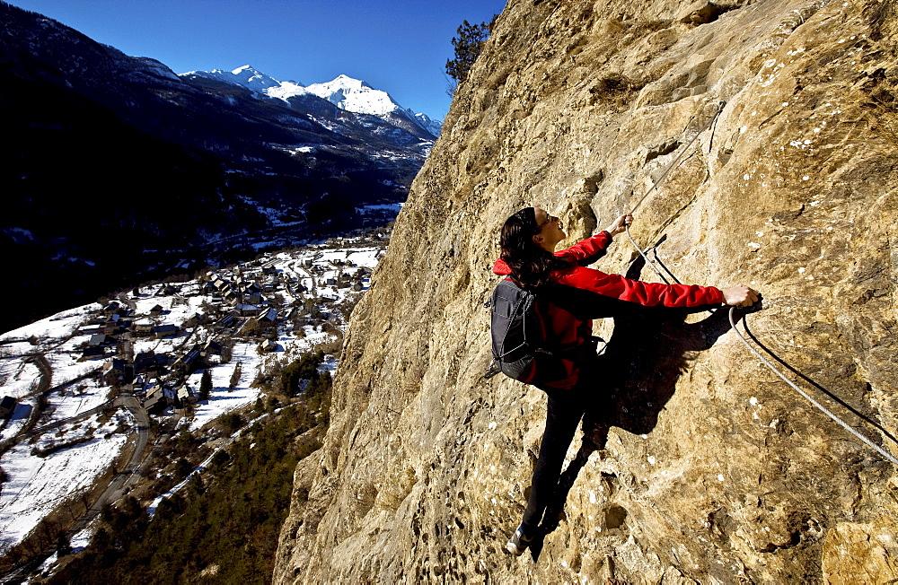 Climbing a via ferrata course near Vallouise, Ecrins Massif, France, Europe