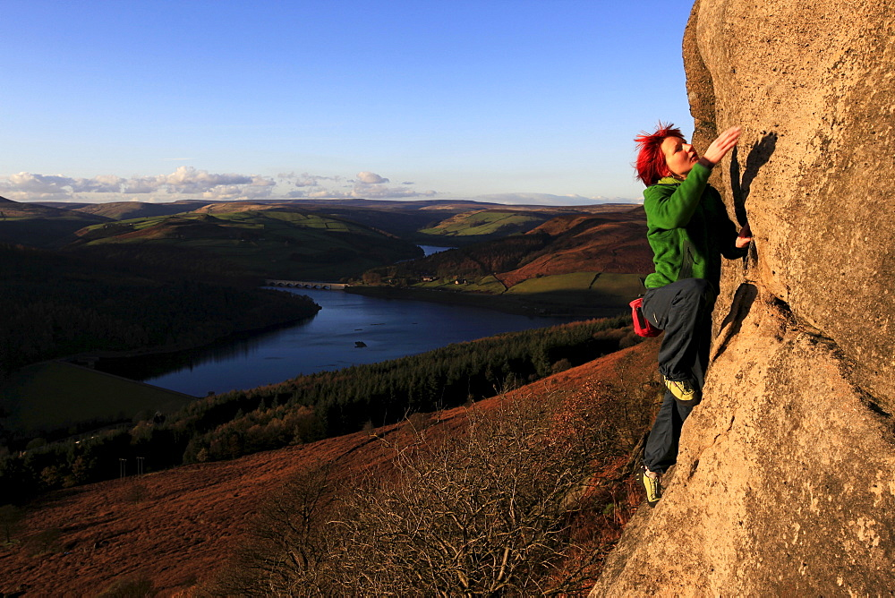 a climber on the gritstone cliffs above the Derwent Reservoir, Peak District, Derbyshire, England, United Kingdom, Europe