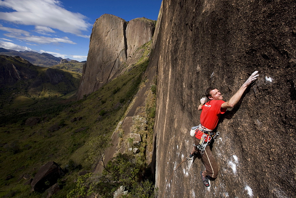 A climber on a very difficult route on the cliffs of the Tsaranoro Massif, Southern Madagascar, Africa