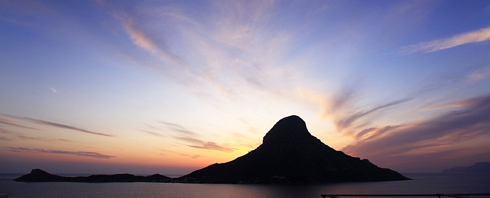 Telendos Island at sunset seen from Massouri, Kalymnos, Dodecanese, Greek Islands, Greece, Europe