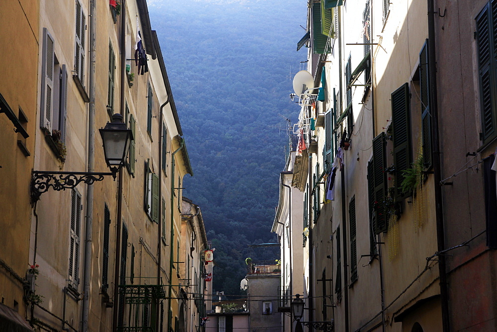 Narrow street in the old town of Finale, Liguria, Italy, Europe