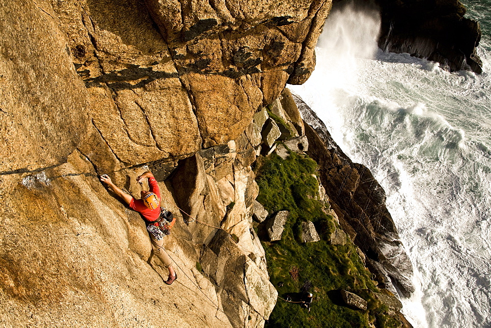 A climber on the classic extreme route Raven Wall on the cliffs at Bosigran, near St. Just, West Penwith, Cornwall, England, United Kingdom, Europe