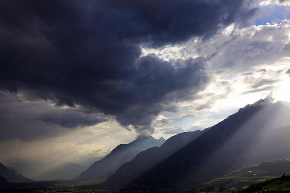 Summer storm clearing over the mountains of the Valais region, Swiss Alps, Switzerland, Europe