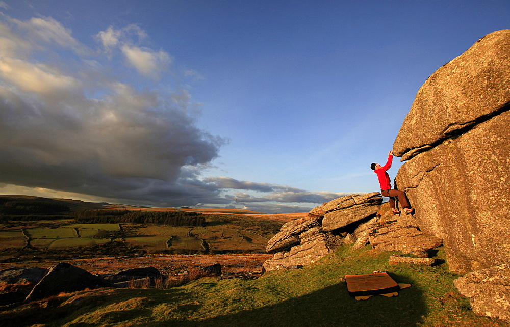 A climber bouldering on Dartmoor, Devon, England, United Kingdom, Europe